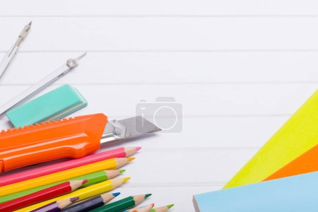 Photo for School supplies and books over a white background - Royalty Free Image