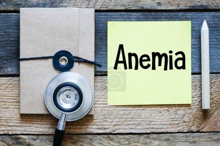 Anémie ext concept, fond en bois