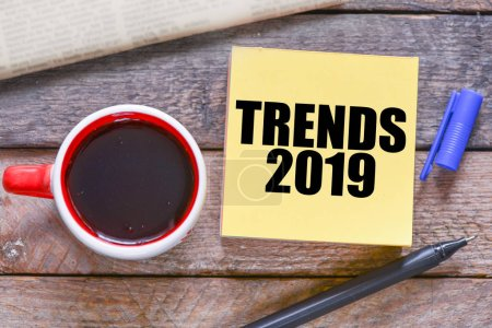 Trends 2019 text concept, wooden background
