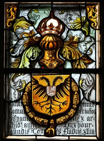 Photo for Bruges, Belgium - August 18, 2018: Stained Glass in the Basilica of the Holy Blood in Bruges, Belgium, depicting the Double-headed eagle or Imperial Eagle, Coat of Arms of the Holy Roman Empir - Royalty Free Image