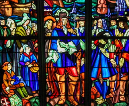 Photo for Mortagne-au-Perche, France - July 20, 2015: Stained Glass depicting the Departure of Pierre Boucher at La Rochelle for Quebec (17th C) in the Notre Dame church of Mortagne, Perche, France - Royalty Free Image