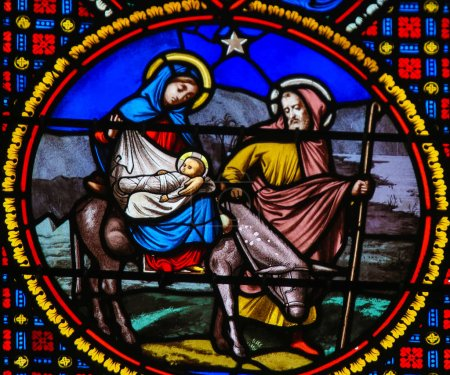 Photo for Saint-Adresse, France - August 15, 2019: Stained Glass in the Chapel of Notre-Dame-des-flots (1857) in Sainte Adresse, Le Havre, France, depicting the Flight to Egypt - Royalty Free Image