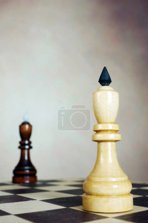 Confrontation. Two chess kings stand on opposite corners of a chessboard. Conceptual image