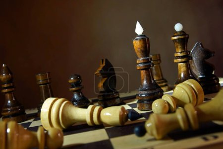 Black chess team won enemies. Total victory. Concept with wooden chess pieces