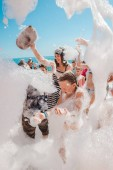 Russia, Tuapse July 4, 2019. Children have fun at a foam party on the beach.