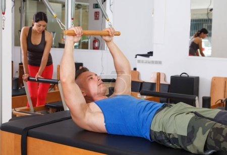 Photo for People in the gym with modern fitness equipment - Royalty Free Image