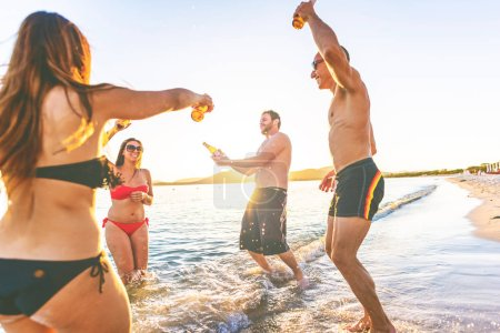 Photo for Group of friends millennials having fun on the beach - Royalty Free Image