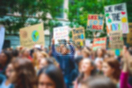 Photo for Blurred crowd protesting - Activist manifestating in the city marching - Royalty Free Image