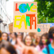 Tilt Shift of people holding picket signs climing ...