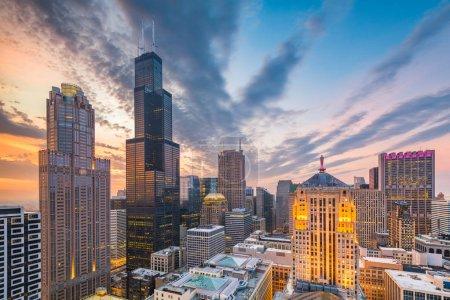 Chicago, Illinois, USA aerial downtown skyline at dusk towards Lake Michigan.