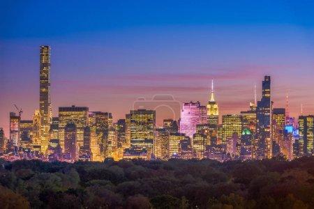 New York, New York midtown Manhattan cityscape over Central Park at twilight.