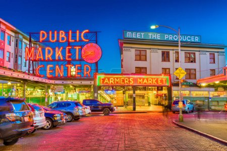 SEATTLE; WASHINGTON - July 2; 2018: Pike Place Market at night. The popular tourist destination opened in 1907 and; is one of the oldest continuously operated public markets in the United states.