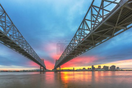 Photo for New Orleans, Louisiana, USA downtown skyline on the Mississippi River below the Crescent City Connection Bridge. - Royalty Free Image
