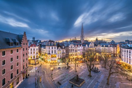 Photo for Brussels, Belgium plaza and skyline with the Town Hall tower at dusk. - Royalty Free Image