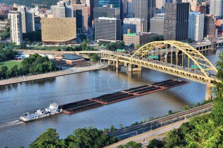 Industrial river shipping. Pittsburgh city, Pennsylvania. Monongahela River barge transport of coal.