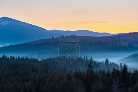 Photo for Early morning spring Carpathian mountains plateau landscape with snow-covered ridge tops in far, Ukraine. - Royalty Free Image
