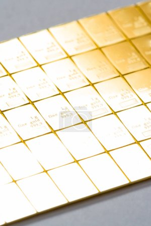 Close up of a bar of gold as a physical holding of precious metals