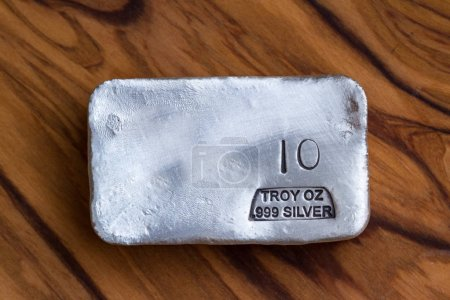 Close up of a 10 gram bar of poured silver as a precious metal holding