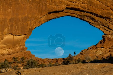 Photo for Beautiful view of the full moon rising thru north window in Arches National park - Royalty Free Image