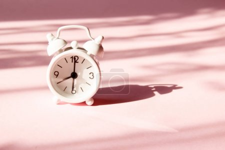 Photo for Alarm clock on pink background. Morning time background concept. - Royalty Free Image