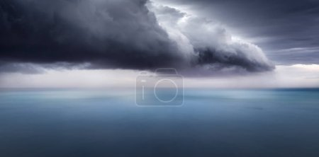 A dark storm cloud over the ocean