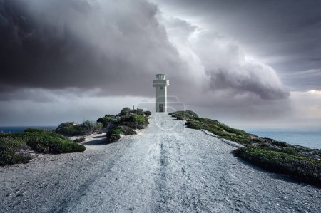 A lighthouse standing tall in a storm