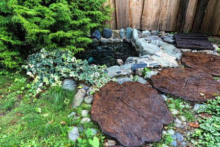 beautiful landscape design with wood and water summer green
