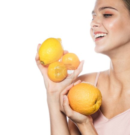 Photo for Beauty portrait of attractive young caucasian happy smiling woman isolated on white studio shot eating orange  lemon fruit fresh healthy food raw diet - Royalty Free Image