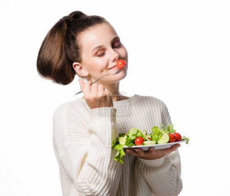 Photo for Portrait of attractive young caucasian smiling woman isolated on white studio shot eating salat - Royalty Free Image
