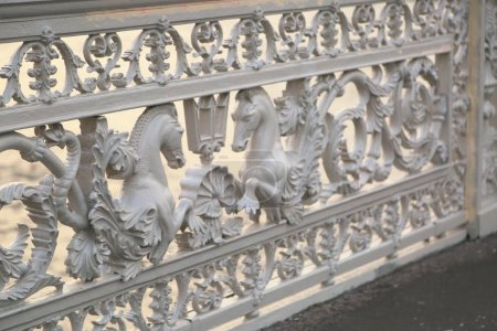Photo for Horse fragment fencing of Blagoveshchensky Bridge in Saint Petersburg, Russia/St. Petersburg, openwork cast iron railings of the Blagoveshchensk bridge over the Neva river - Royalty Free Image