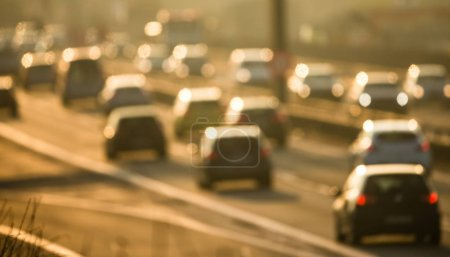Photo for Cars going very slowly in a traffic jam during the morning rushhour - blurred photo - Royalty Free Image