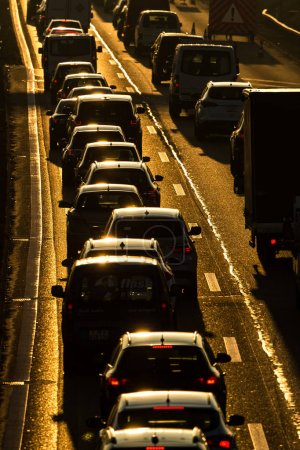 Photo for Heavy morning city traffic/congestion concept - cars going very slowly in a traffic jam during the morning rushhour - Royalty Free Image
