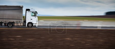 Photo for Transportation theme. Road cars theme. Truckers heaven. Truck going fast on a highway. - Royalty Free Image
