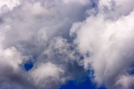 Dense and great white clouds were formed on a beau...