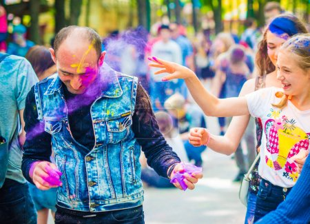 People sprinkle colorful paints during celebrating holi fest
