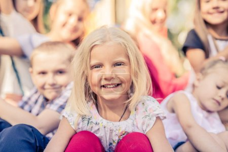 Photo for Smiling Little Kids sitting together - Royalty Free Image