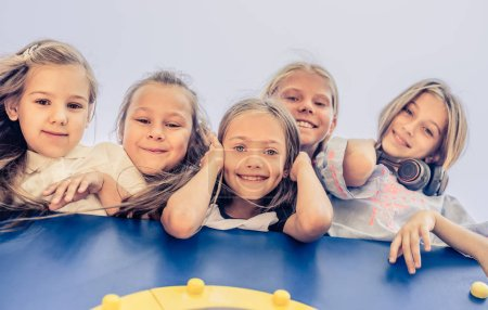Photo for Little happy smiling kids together bottom view at playground - Royalty Free Image