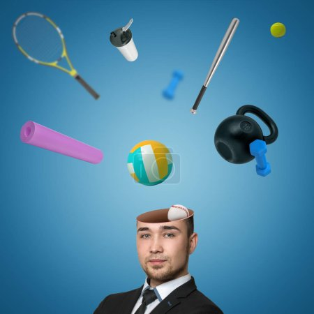 A view of a handsome young mans head cracked open with various sports equipment popping out isolated on blue background.