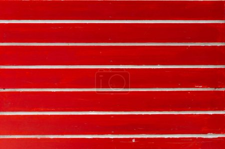 Red texture of pine wood grain with knots. Abstract red backgrou
