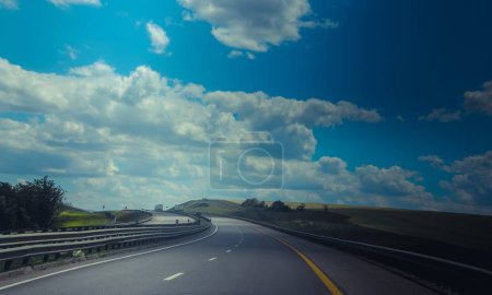 Photo for Russian asphalt roads. Highway. Road trip. The car goes on the road. Background asphalt road. Landscapes of Russia - Royalty Free Image