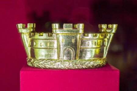 Gold and jewell-studded Kings crown close-up in th...