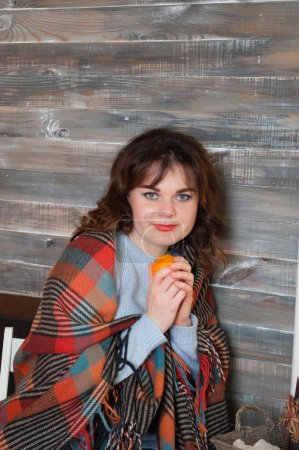 Photo for Very happy young beautiful woman holding an orange in her hands - Royalty Free Image