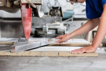 Photo for Stone mason woman measuring stone plate for sawing in workshop - Royalty Free Image