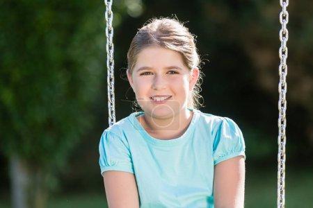 Photo for Happy kid having swingtime at adventure playground - Royalty Free Image