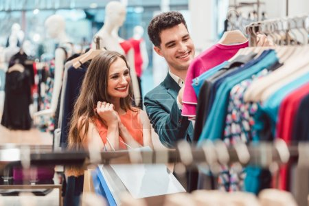 Couple shopping for fashion items in high end boutique