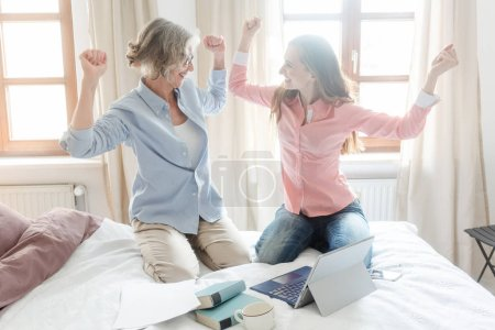 Mother and daughter working together giving high-five