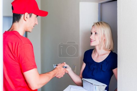 Delivery man taking payment from female customer