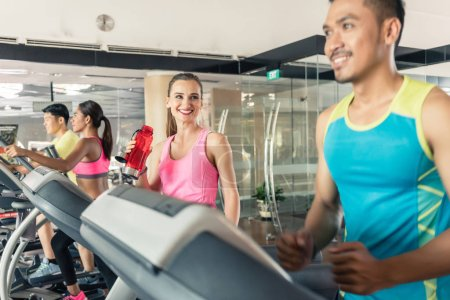 Fit active woman running on treadmill during workout