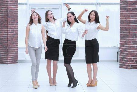 full-length portrait of the triumphant business team.teamwork