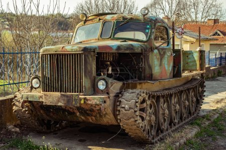 Photo for Krasen village, Bulgaria - April 01, 2017. Old crawler on the side of the road in the Krasen village, Bulgaria - Royalty Free Image